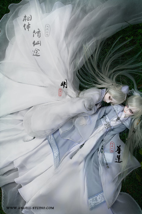 Two silver-haired angels lying close to each other, their traditional Chinese robes billowing around them like wings.