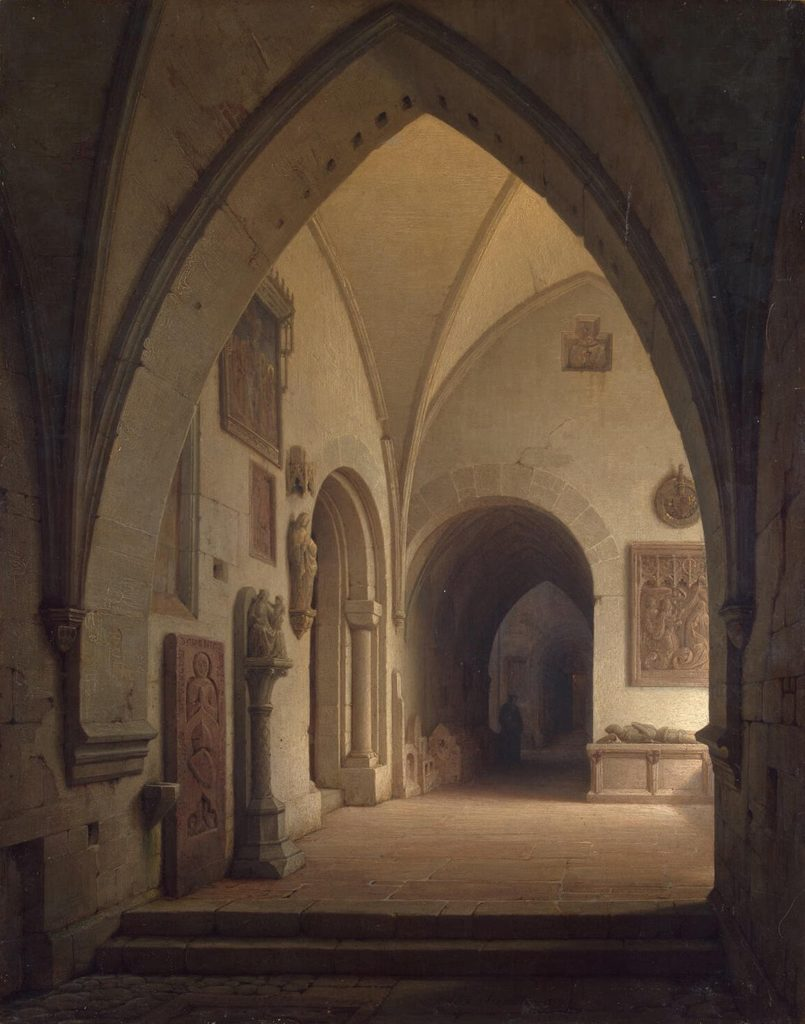 Fine art painting. A corridor inside a church, seen through a gothic arch. Paintings, plaques, and statuary of Roman Catholic figures adorn the walls: the Virgin Mary, Jesus the child, various saints. Two archways are seen in this corridor, leading deeper into the shadowed interior, where a shadowy figure stands. To the right an unseen glow of light illuminates this corridor. A warm, soft, peaceful comfort permeates this view.